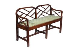 A mahogany chair back settee