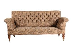 A Victorian oak and button upholstered sofa