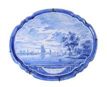 A Dutch Delft blue and white horizontal wall-plaque