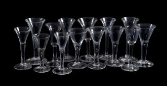 Fourteen various plain-stemmed wine glasses