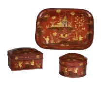 A group of red and gilt painted tinware (toleware) desk items
