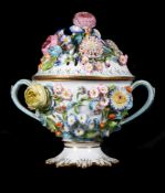 An English porcelain flower-encrusted pot pourri urn and cover of Coalbrookdale type