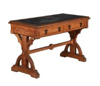 A Reformed Gothic oak and inlaid writing table