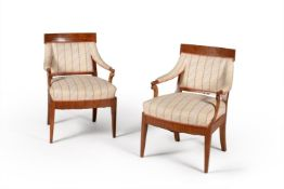 A pair of North European elm open armchairs