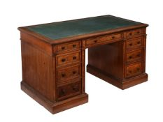 A Victorian oak and walnut pedestal desk, by Gillow & Co