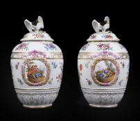 A pair of German porcelain Berlin style vases and covers with eagle finials