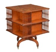 A satinwood and polychrome painted revolving bookcase