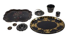 An assortment of Victorian black lacquer papier mache wares