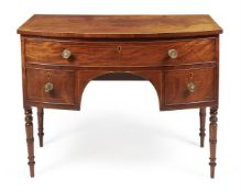 A Regency mahogany and line inlaid bowfront sideboard