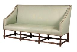 An oak and upholstered sofa