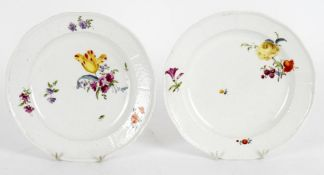 Two Meissen (Punkt) plates; and a Nymphenburg part set