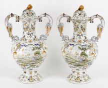 A pair of 19th century French faience large baluster vase and covers in the Moustiers style