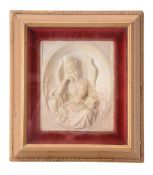A Victorian sculpted alabaster relief of a maiden reading