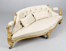 A Victorian giltwood framed low sofa