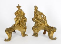 A pair of ormolu chenets in Louis XV Chinoiserie taste