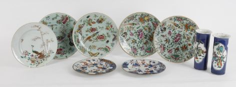 A set of four Chinese famille rose plates on celadon ground
