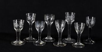 Eight 18th century and later engraved small wine glasses
