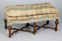 A walnut and tapestry long stool in the early 18th century manner