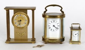An early 20th century French brass carriage timepiece of oval form