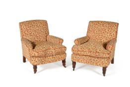 A Victorian armchair and a modern armchair upholstered to match