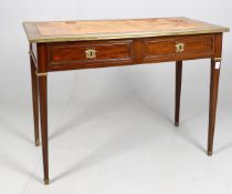 A French mahogany and gilt metal mounted bureau plat