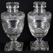 A pair of late 19th century cut glass vases and covers