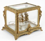 A late 19th century French gilt metal and bevelled glass cased liquor set