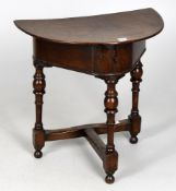 An 18th century and later oak demi-lune flip top side table