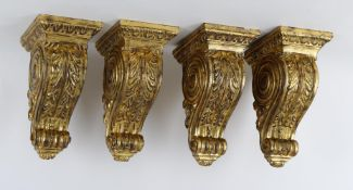 A set of four modern giltwood wall brackets in 18th century style