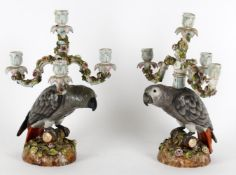 A pair of late German four branch 'parrot' candelabra