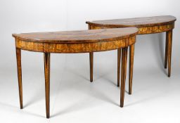 A pair of George III style mahogany console tables