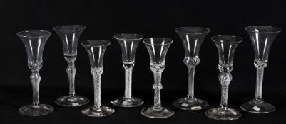 Mid-18th century wine glasses including a pair of air twist wine glasses with bell bowls