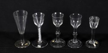 18th century drinking glasses including a plain drawn wine flute
