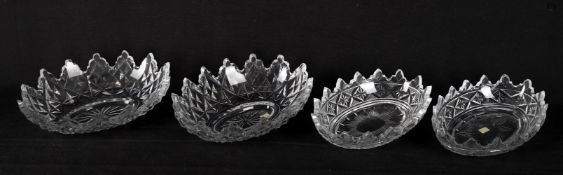 A pair of cut glass epergne dishes with castellated rims