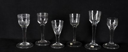 Six 18th century wine glasses including a plain stemmed glass