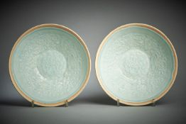 A pair of Chinese qingbai moulded bowls
