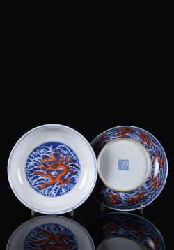 A fine pair of iron-red and underglaze-blue 'Dragon' dishes