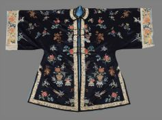 A Chinese midnight blue satin silk lady's front opening robe