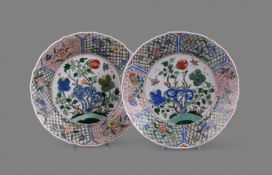 A fine pair of Chinese porcelain famille verte circular lobed plates