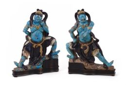 Two large Chinese large blue and aubergine Fehua-glazed 'heavenly guardian' pottery tile-figures