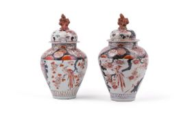 A pair of Japanese Arita vases and covers