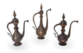 Three Qajar damascened and engraved steel ewers