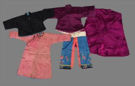 A group of four children's robes and jackets and a pair of blue damask embroidered pantaloons