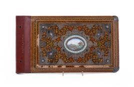 A painted wood and silver mounted and enamel book cover