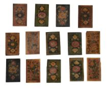 A group of 14 wooden floral book binding boards
