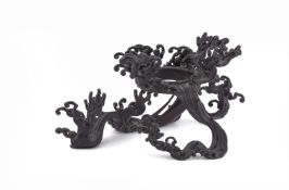 An attractive Japanese bronze 'breaking wave' vase stand