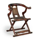 A Chinese lacquered wood folding horseshoe back folding chair