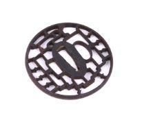 A Japanese Iron Kyo-Sukashi Tsuba of circular form pierced in ji-sukashi with the Yatsuhashi (eight