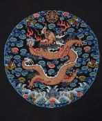 A Chinese Imperial silk 'Dragon' roundel