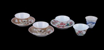 A pair of Chinese Famille Rose 'Cockerel' tea bowls and saucers